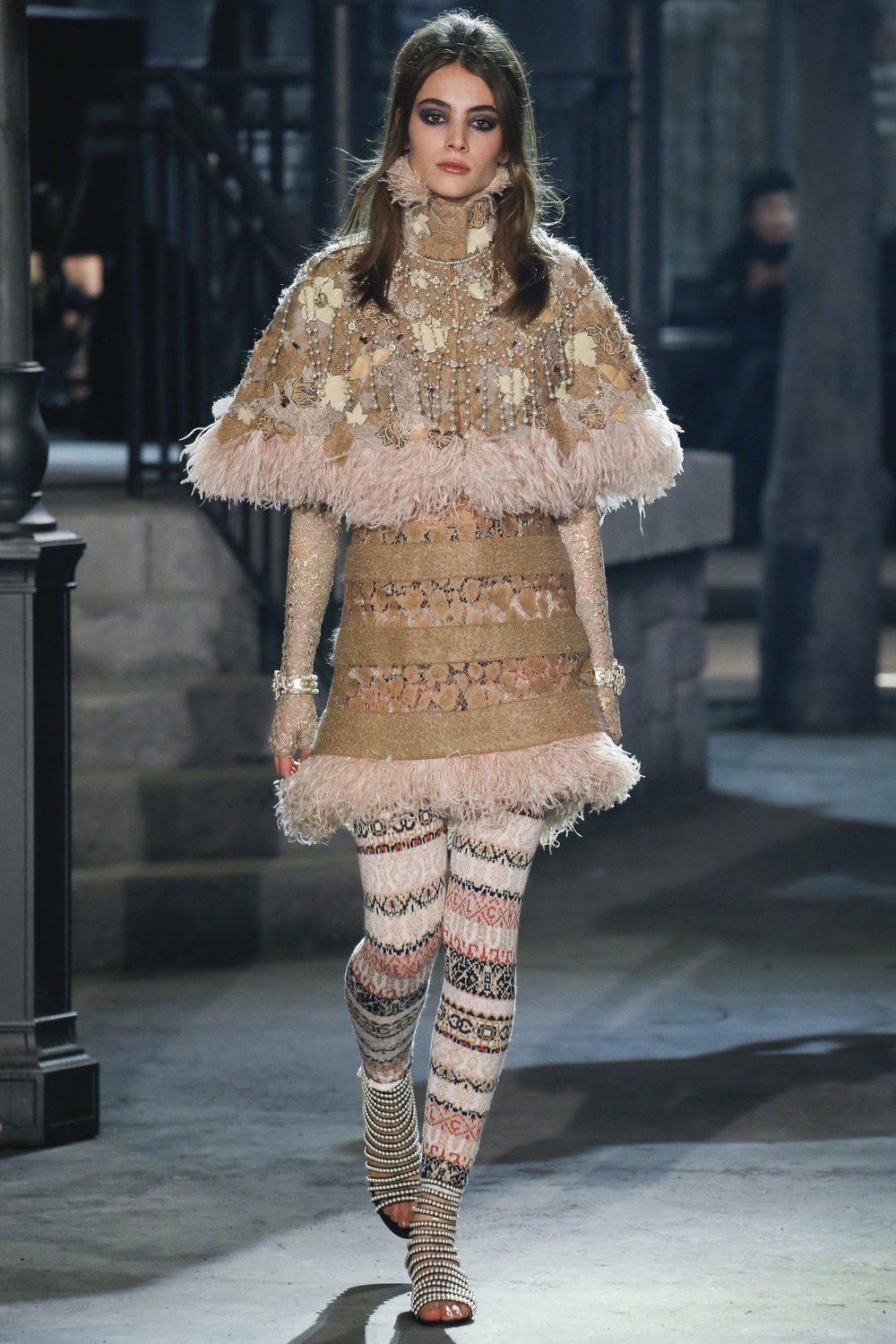 A model walks down the runway in an outfit from the Chanel Pre Fall 2016 collection.