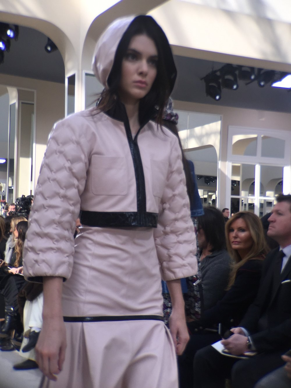 Paris Fashion Week Chanel Fall 2016 - Kendall Jenner in a pale pink leather hoodie