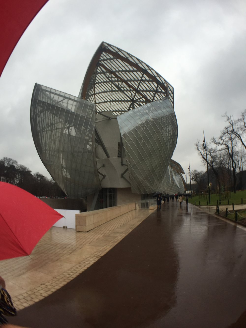 The show was held in geometric tents outside the Louis Vuitton Foundation building. It's an art museum and cultural center designed by architect Frank Gehry.