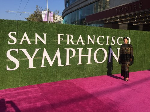 Chrisa Pappas wears a Spring 2016 Valentino black suede cape and skirt with a Dolce & Gabbana bustier top to the San Francisco Symphony Opening Night Gala.