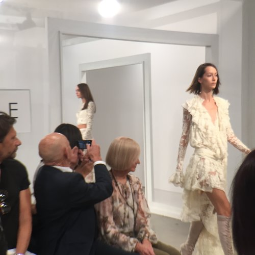 Heavy on lace, tulle, and embroidery along with a harmonious palette of cream, lilac, steel blue, and dusty peach, the collection had an unmistakable Eighties twist.