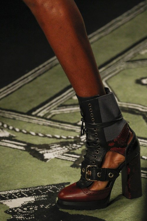 Burberry Fall 2016 Ready to Wear Collection - Accessories were key to the collection with heavily detailed miniature bags and military inspired high heeled boots.