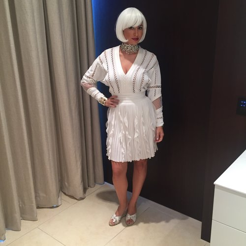 Chrisa Pappas wears a white Givenchy dress, $17 white wig and crystal headpiece made into a choker.