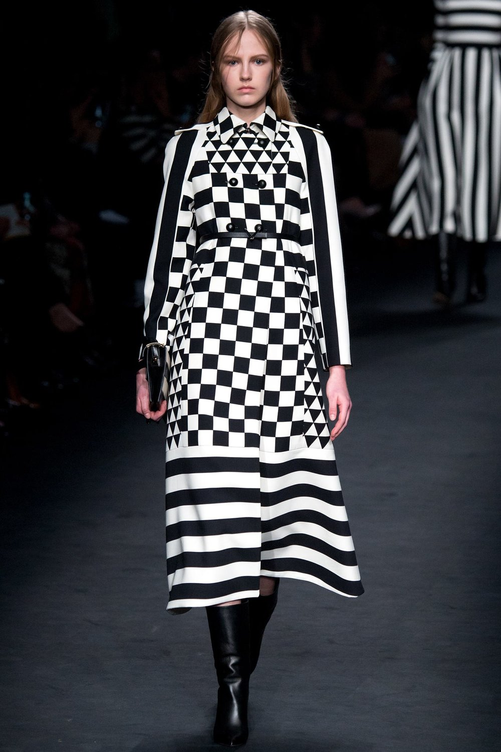 A Valentino black and white trench coat on the runway.