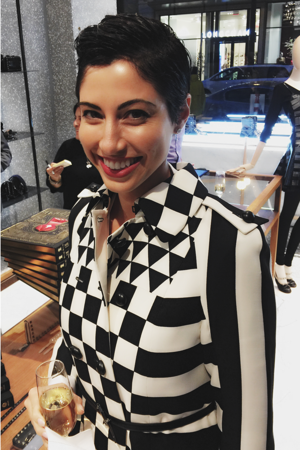 Chrisa Pappas wearing a black and white Valentino trench coat to Ken Fulk's book signing in Valentino San Francisco.