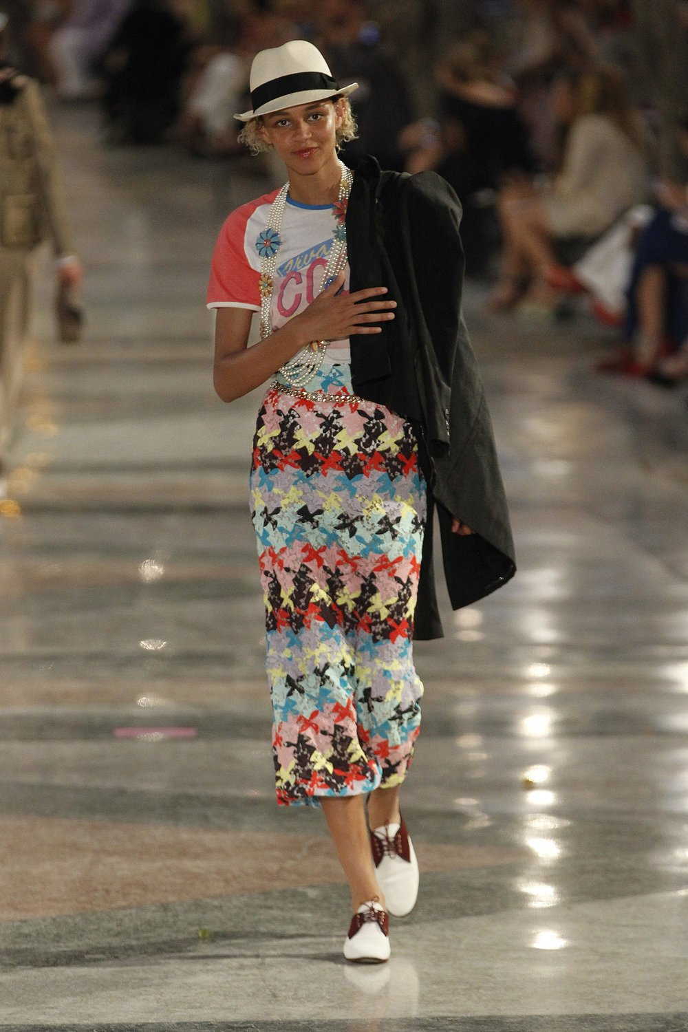 A model walks down the runway in a look from the Chanel Resort 2017 Collection.