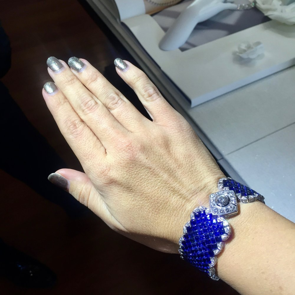 Chrisa Pappas tries on Chanel jewelry