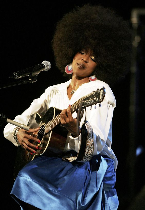 LAURYN HILL WITH AFRO AND GUITAR.jpg