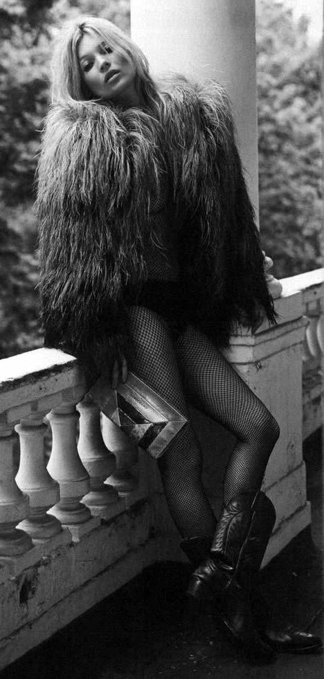 kate moss in feathers blakc and white.jpg