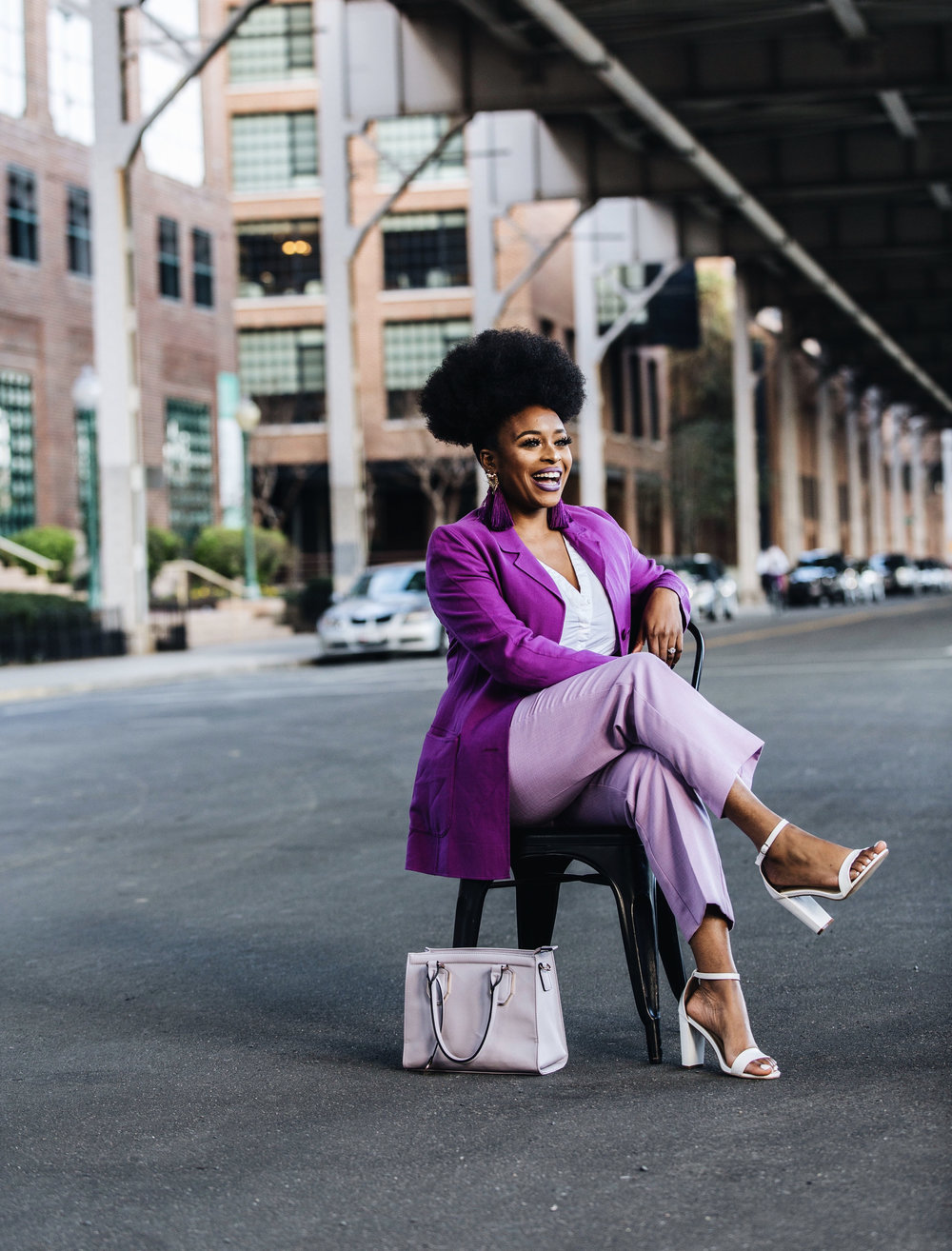 Image of beauty & lifestyle influencer ronkeraji wearing a lavender pants, purple and white heels laughing captured by photographer The Creative Gentleman for Fashion Bomb Daily. This image was taken during the Conversations with Claire brunch event in Washington, D.C.