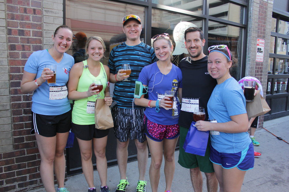 Group of good friends enjoying their post-run beers.