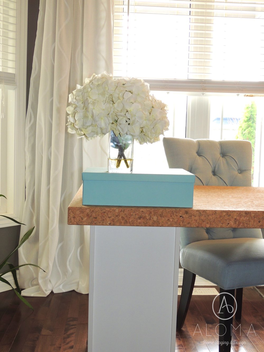 White hydrangeas-Desk and blue chair by ALOMA Home Staging & Design