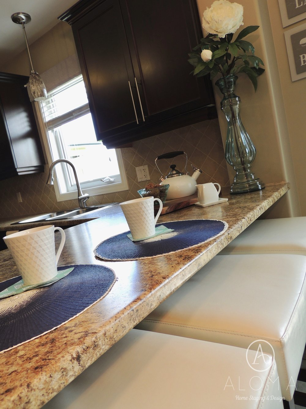 Cup of coffee- Place setting on kitchen counter by ALOMA Home Staging & Design