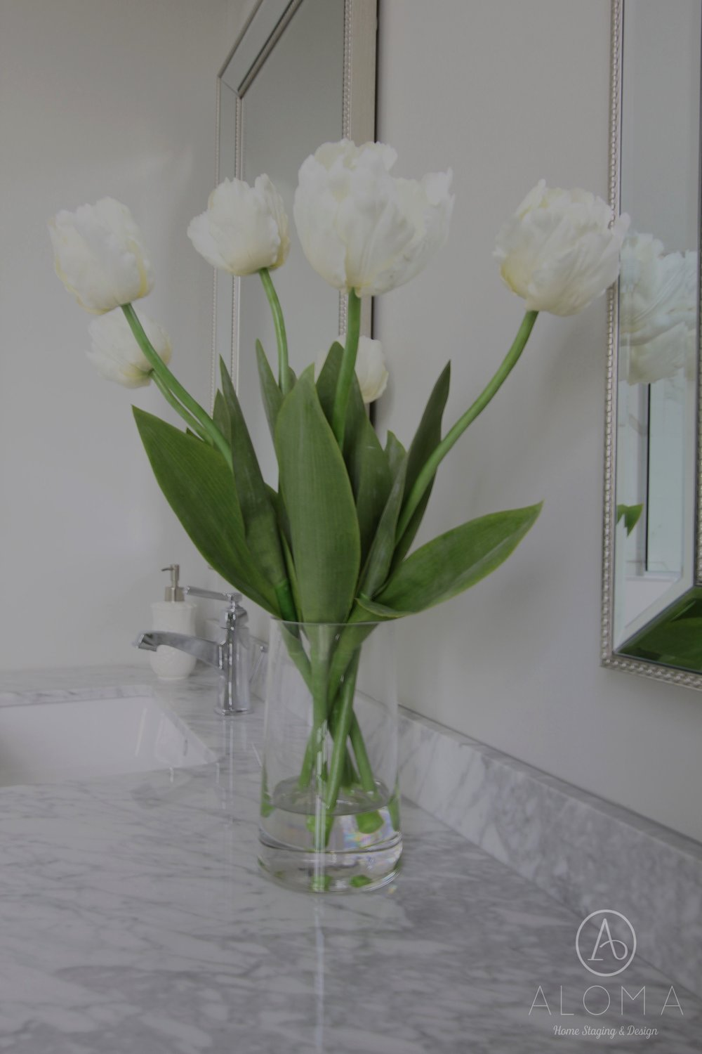 White tulips in bathroom by ALOMA Home Staging & Design