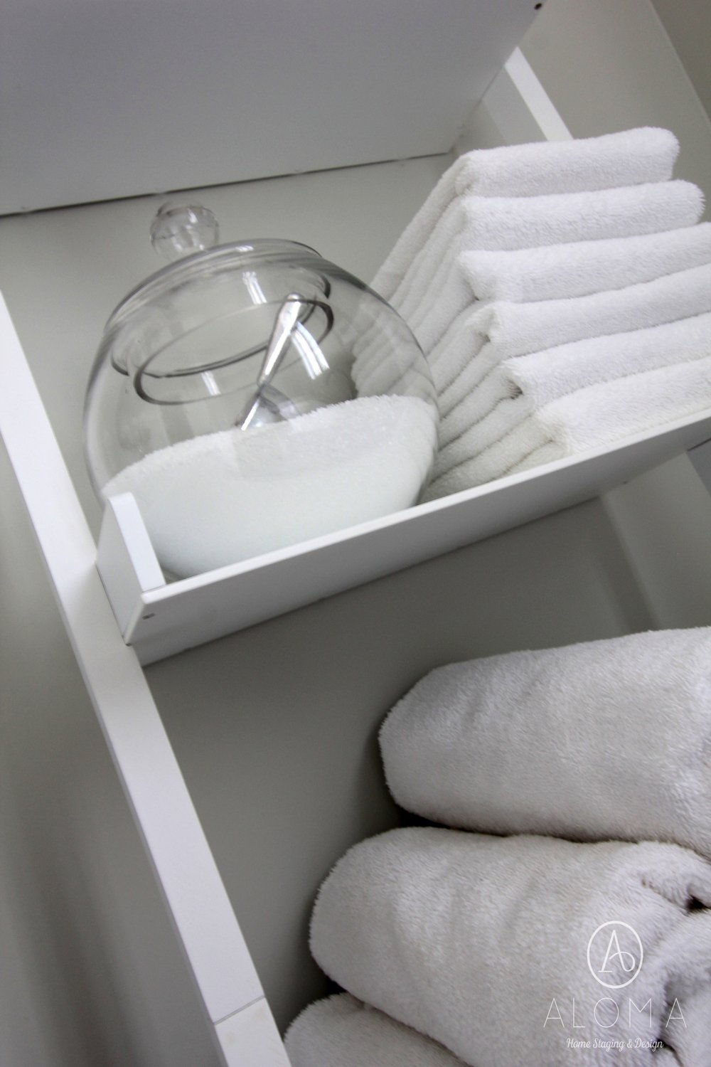 White towels and epsom salt display by ALOMA Home Staging & Design