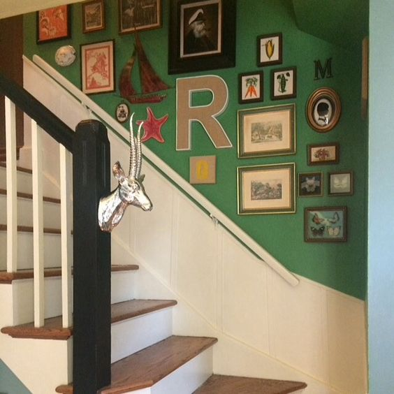 I love this preppy stairwell gallery wall by  Maura Jane Interiors.
