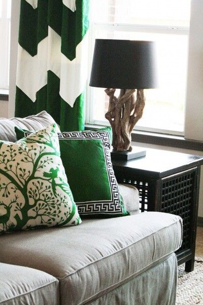 Playful and classic patterns in the same shade of emerald are elegant against the neutral backdrop of this room.