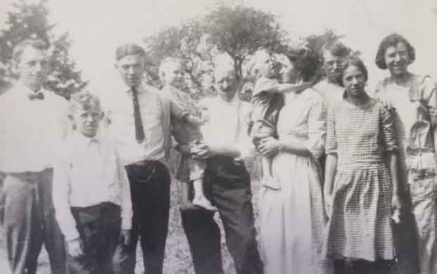 L to R: John, Clarence, Henry , Epp, Sosthenes Fischesser, Wes,Kate Schwartz Fischesser, Leo, Alma, Catherine. c. early 1920s. (note: ids may not be accurate)
