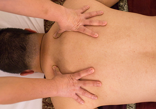 man receiving a deep tissue massage at bangkok day spa