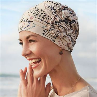 LOTUS PRINTED TURBAN by Christine Headwear  features a chic lotus flower, and is available in both khaki and pink.