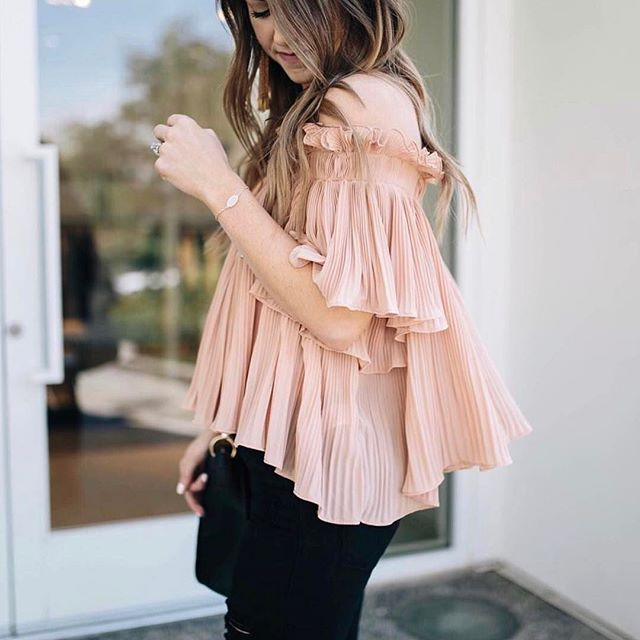 @darylanndenner makes us want to twirl into summer in the Bella Top. (We love that it has small straps that can be worn on or off) Order yours online now- there are only a couple left!