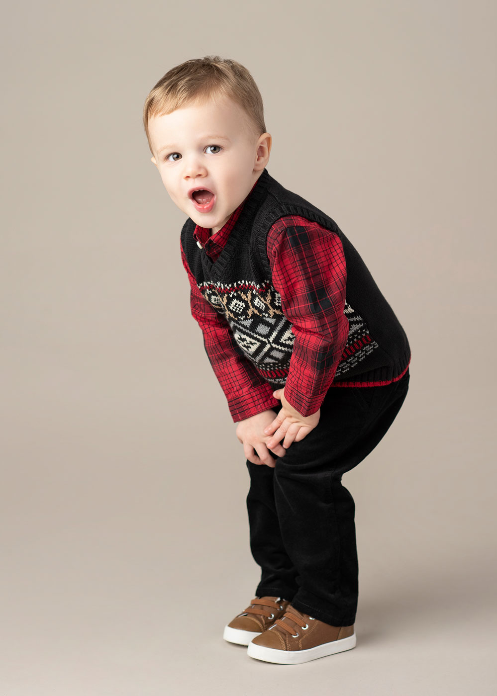 Portrait of toddler boy wearing Christmas outfit