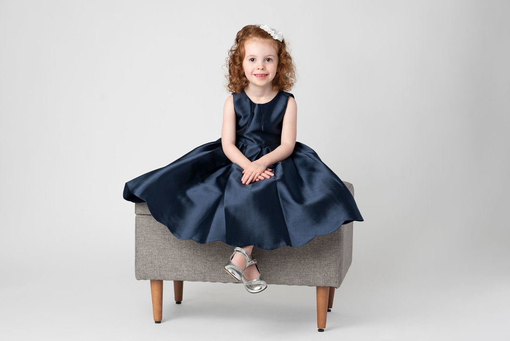 Christmas photo of girl in blue dress