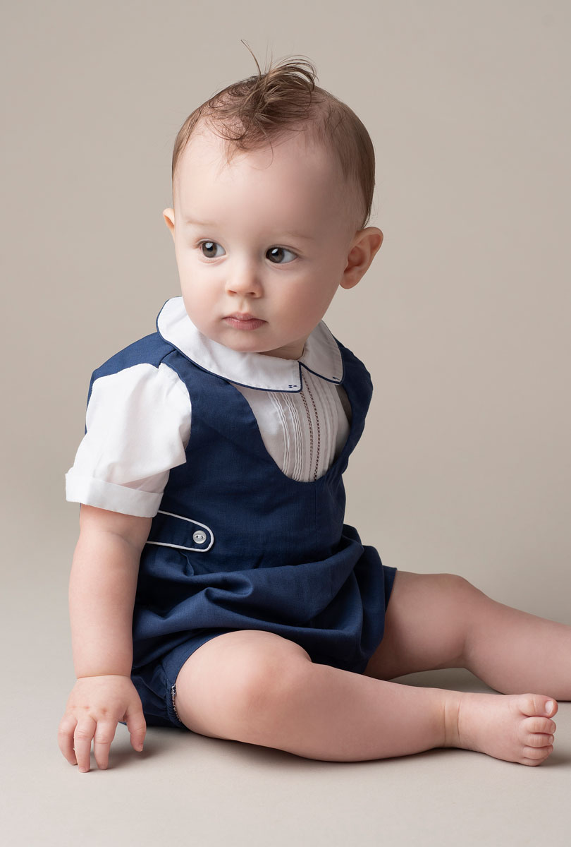 Studio portrait of baby boy in blue