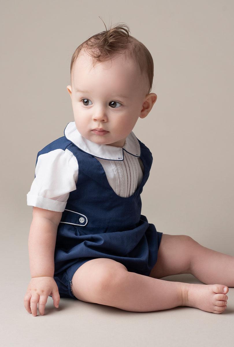 Studio portrait of baby boy in blue