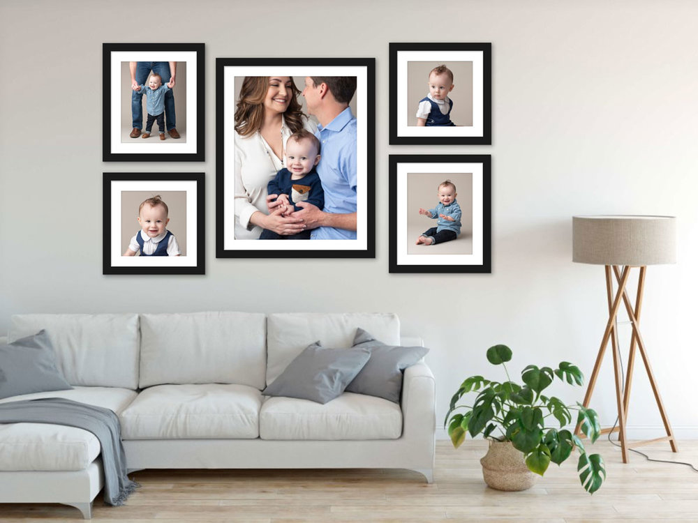 Framed family photos on living room wall