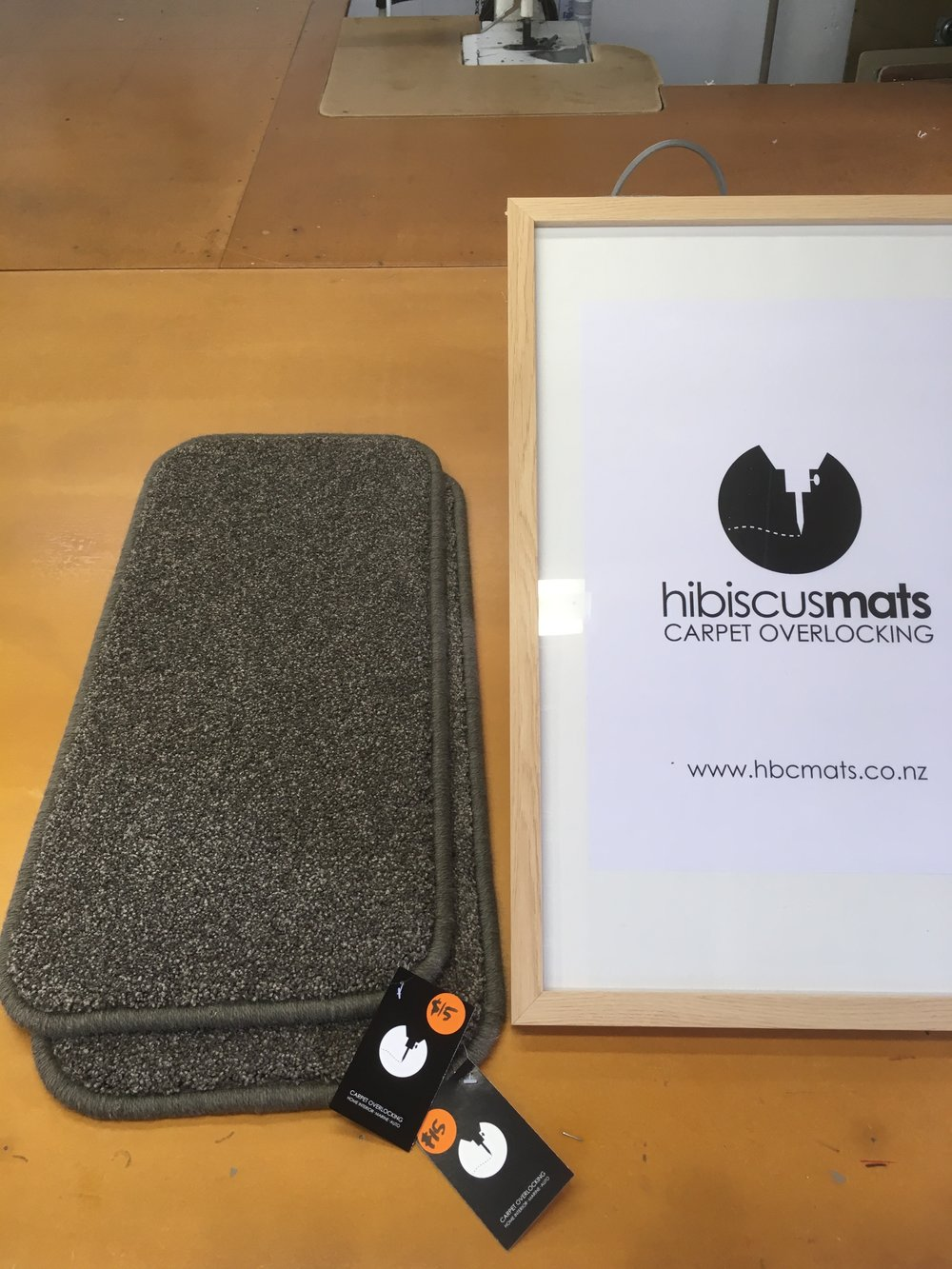 Carpet Mat 0.65m x 0.30m by Hibiscus Mats Carpet Overlocking $15 - Solution dyed nylon carpet mat cut & overlocked by Hibiscus Mats Carpet Overlocking. - Measures 0.65m x 0.30m- Colour: Charcoal Grey- Rounded corners to prevent curling- Can be gripped with Giltgrip Rug Grip for an additional fee