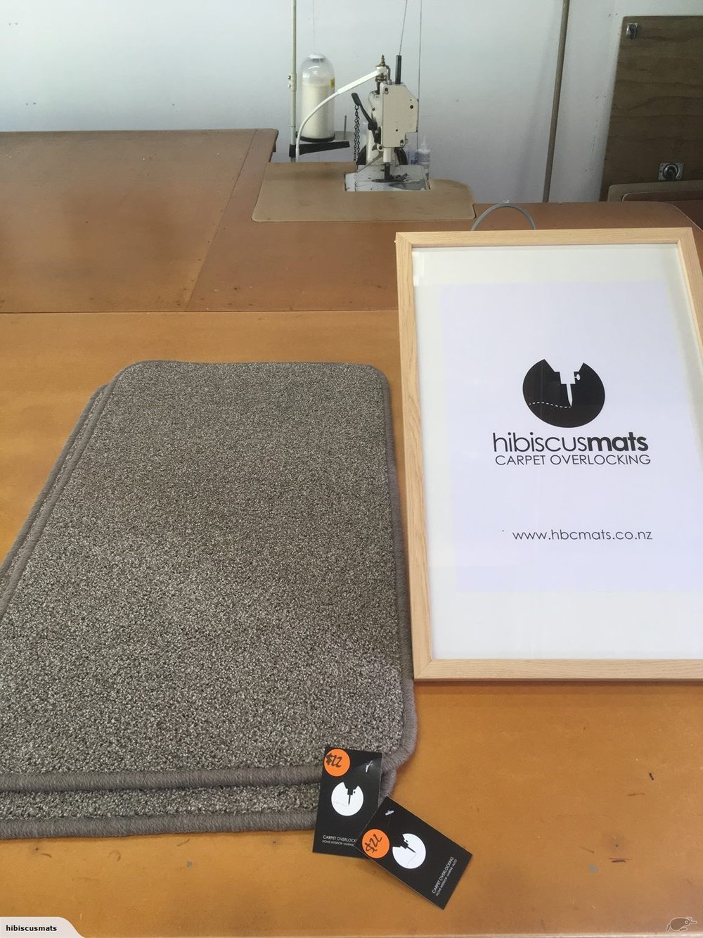 Carpet Mat 0.85m x 0.48m by Hibiscus Mats Carpet Overlocking $22 - Solution dyed nylon carpet mat cut & overlocked by Hibiscus Mats Carpet Overlocking. - Measures 0.84m x 0.48m- Colour: Taupe- Rounded corners to prevent curling- Can be gripped with Giltgrip Rug Grip for an additional fee