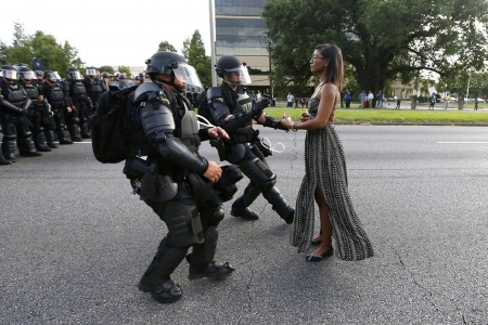 An iconic image of protestor Ieshia Evans at Baton Rouge in 2016. The parallels and irony between this image and the depiction in Pepsi's ad is both baffling and harrowing.  Source:   Jonathan Bachman/Reuters