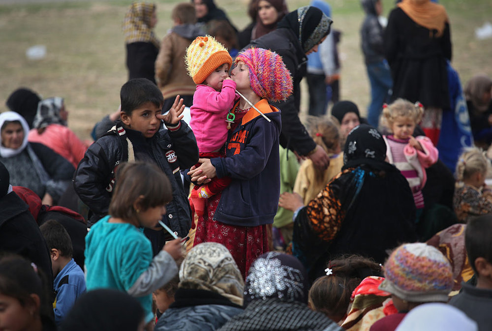 Photo by John Moore/Getty Images News / Getty Images  2014: Civilians Flee War As ISIL Frontline Shifts Following Kurdish Sinjar Offensive by John Moore