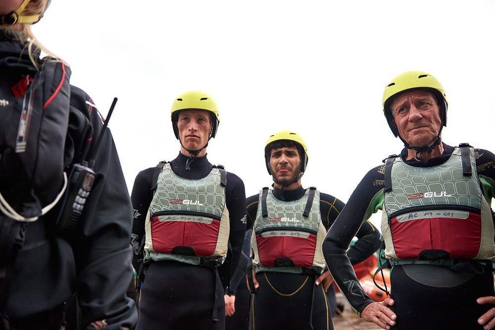 Commissioned to create promotional material for the NGO Atlantic Pacific International Rescue Boat Project. These images were taken at one of their training camps on the Welsh coast.     Atlantic Pacific /  Team members listen to their boat assignments and roles, ahead of a morning drill / South Wales, Wales /