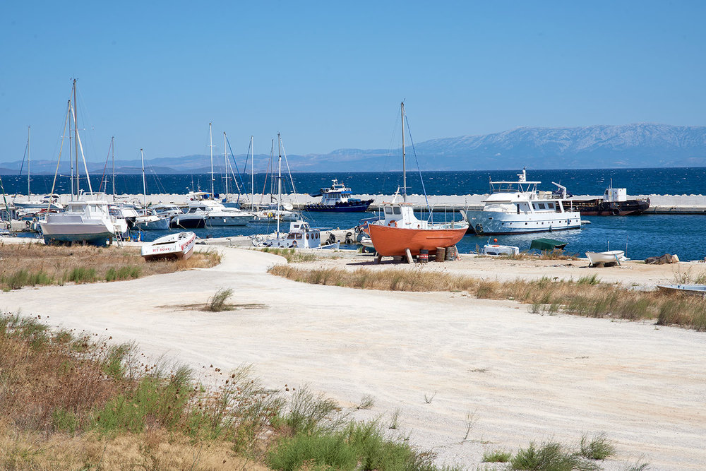 The closeness of the Greek islands to the Turkish coastline makes Greece a popular landing point for those seeking refuge in Europe. Pictured here, fishing boats at a harbour in Chios, Greece. In the background is neighbouring Turkey.