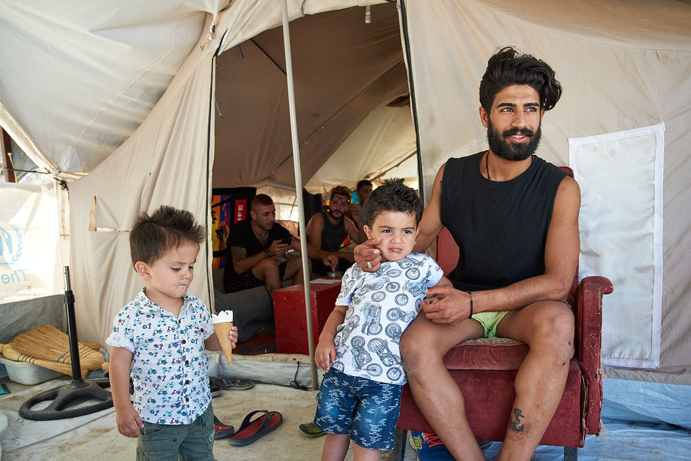 Mohammed, from Syria, and his two sons. Souda Camp, Chios, Greece.