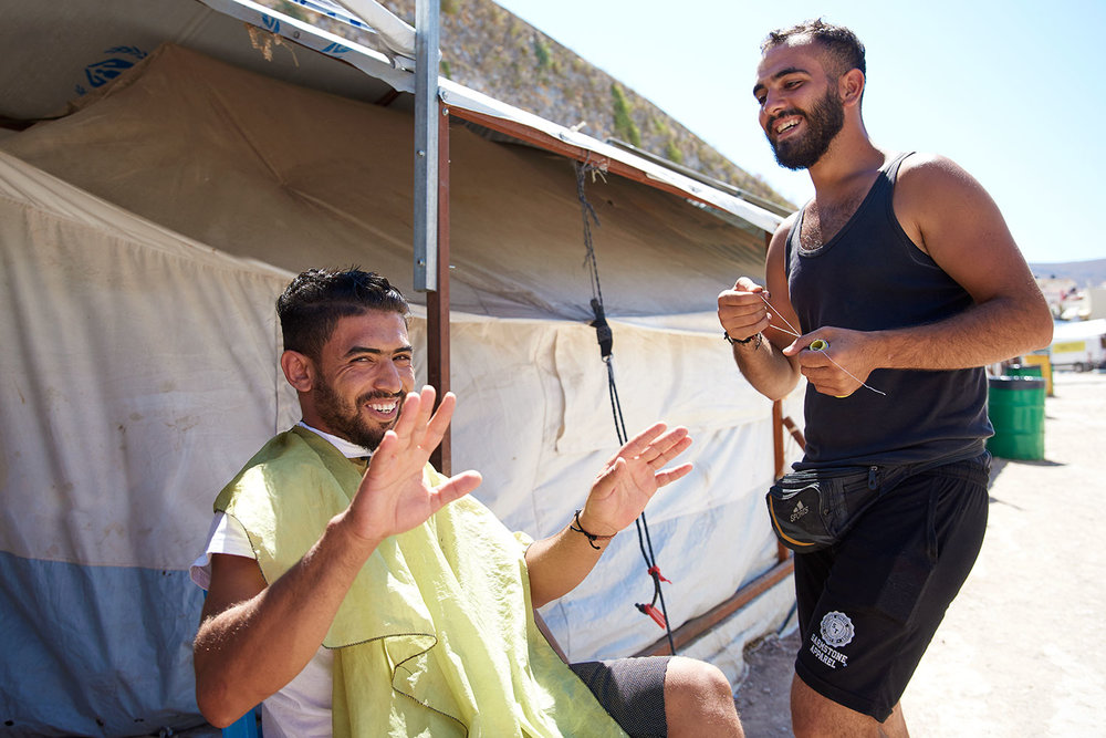 Ahmad (right) was a barber in Syria. Souda Camp, Chios, Greece.