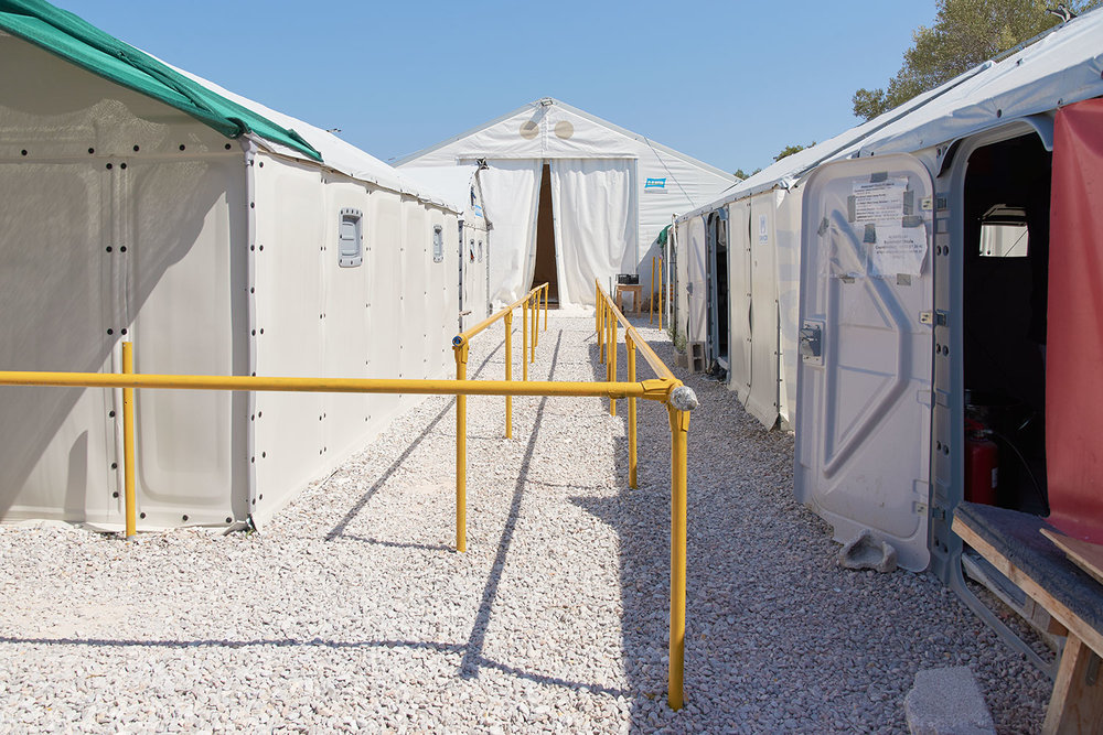 Their combined efforts bring the migrants here, Stage 2, an in transit camp where they are registered with the local police and provided with a dry change of clothes, freshly cooked meals, tea and shelter, until they are transferred to Moria Refugee Camp.