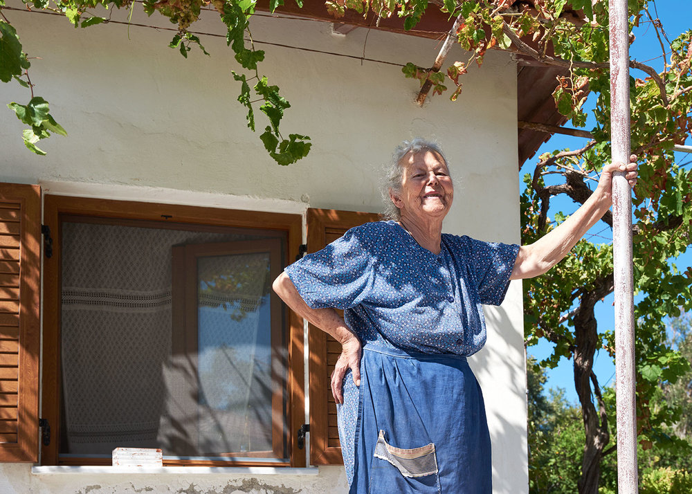 For their efforts during the refugee crisis some residents of Skala were nominated in 2016 for the Nobel Peace Prize. Martisa Mavrapidi, pictured here on her porch in Skala, is one those who was nominated. Martisa, now 86, and two other elderly ladies washed clothes and cooked for the refugees that came in. Some Skala fishermen who helped save the lives of some stranded at sea were the others nominated.