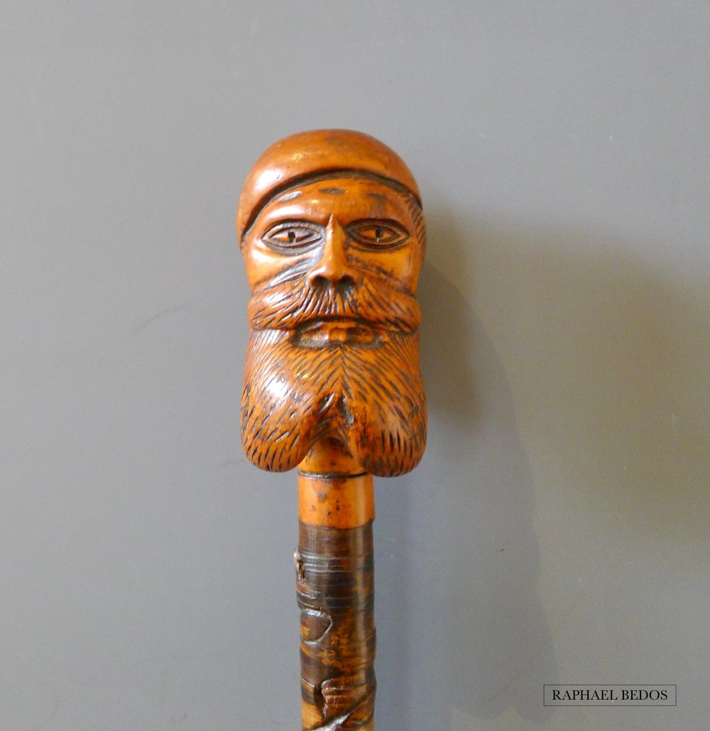 14.Canne de défense, pommeau tête de marin en buis  Signée L.Leroy, Férule facettée en bronze
