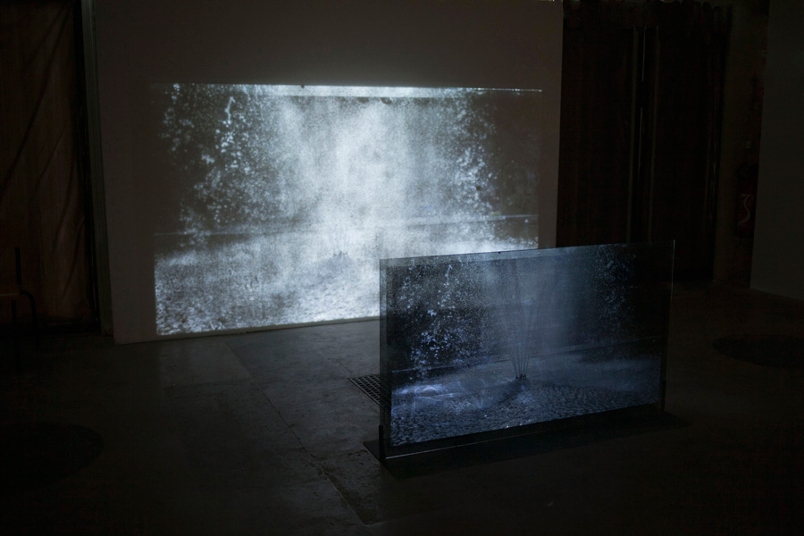 Célia Gondol  Aquam Perdere  2012 video, glass, ink, steel 140 x 80cm