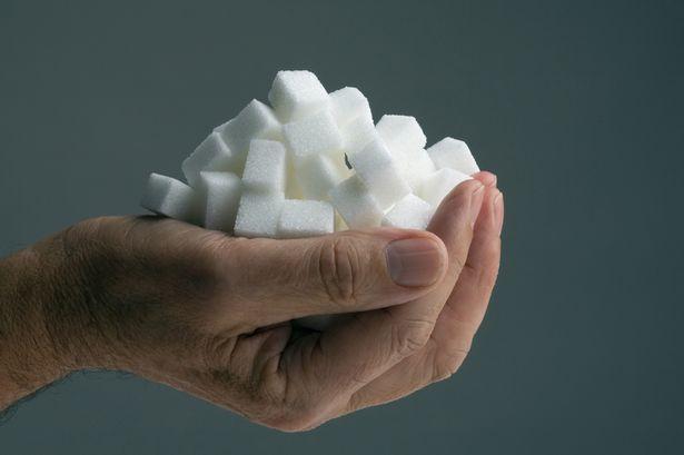 Hand-holding-sugar-cubes.jpg