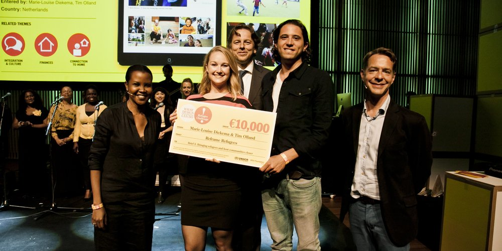 That's me (on the left) distributing checks to winners of the Global Refugee Design Challenge. Winners were given checks to accelerate their winning ideas for solving complex refugee challenges.