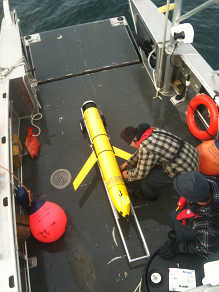 Securing the ocean glider for transport back to land.
