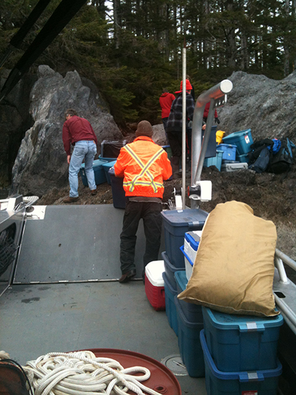 Volunteers help load the research camp equipment for transport back to town.