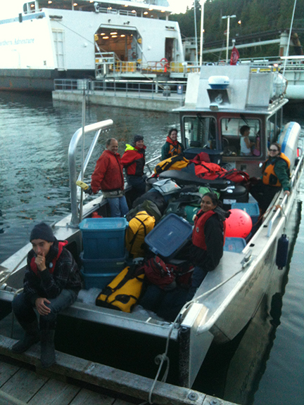 Delivering the research crew, equipment and volunteers safely back to town.