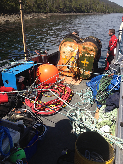 How do you service the underwater portion of a mooring buoy without getting wet? Haul it up on deck!