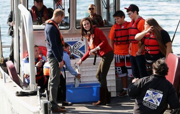 The Duke and Duchess of Cambridge getting up close and personal while fishing in Skidegate inlet with youth from the Skidegate Youth centre.