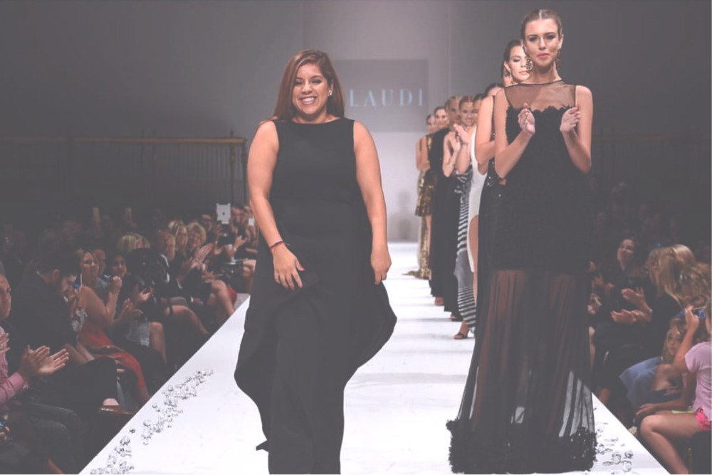 Johana takes a bow after her runway show